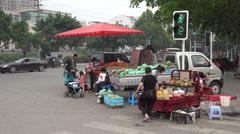 Fruit vendors on street corner in Chengdu, China Stock Footage