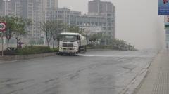 Street cleaner sprays water on road. Stock Footage