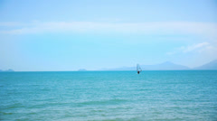 Windsurfing on a Clear Day in a Blue Sea. Thailand. Stock Footage