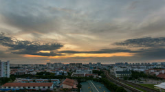 Time lapse zooming out movie of sunrise by Eunos MRT Station in Singapore 1080p Stock Footage