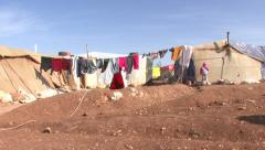 Syrian woman in a refugee camp Stock Footage
