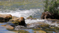 MREZ 24 Clean fresh sparkling water flowing over rocks boulders Stock Footage