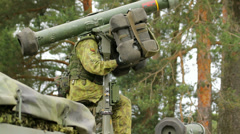 Soldier of Lithuania pointing a missile in the forest, close-up Stock Footage
