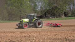 Agriculture tractor cultivated land in spring Stock Footage