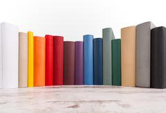 Different colored books Stock Photos