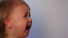 Very expressive little girl crying (close-up) Stock Footage