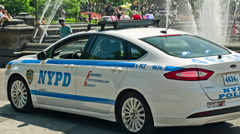 Police Car Driving through Washington Square Park in Manhattan, New York City Stock Footage