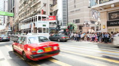 Time lapse of pedestrians and auto traffic at Times Square in Hong Kong Stock Footage