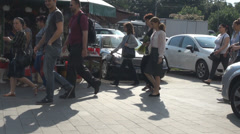 Summer day, busy commuters hurrying to work, walking on pavement, crowded street Stock Footage