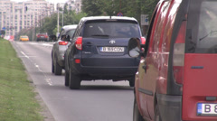 Stock Video Footage of Bucharest Eastern Europe cars traffic in big city, crowded street with two lanes