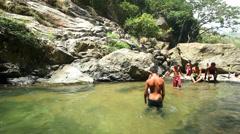 Local boys bathing in Ravana Falls in Ella, Sri Lanka. Stock Footage