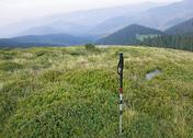 Stock Photo of alpenstock with the background of .carpathian valley and mountains
