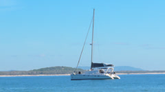 Sailboat moored in clear blue water Stock Footage