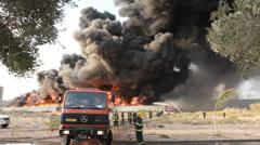 Over 120 firefighters battle blaze in packaging factory Stock Footage