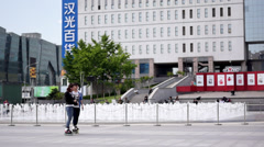 Young girls skating on Xidan square in Beijing Stock Footage