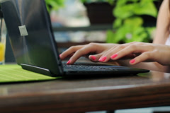Female hands typing on laptop in cafe NTSC - stock footage