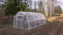 New plastic greenhouse  in spring garden Stock Footage
