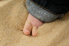 Baby Toes in Sand - stock photo