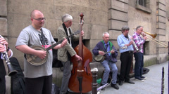 Street musicians seniors group  play before public in Paris Stock Footage