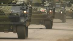 Armored fighting vehicles with soldiers arrive, soldier waves Stock Footage