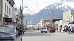 Pedestrian and vehicle traffic in Skagway, AK-HD-P-101 - stock footage
