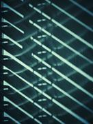 Shade of blinds on the wall Stock Photos