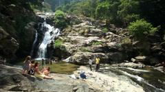 View of people enjoying the Ravana Falls in Ella, Sri Lanka. Stock Footage