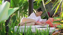 Woman reading book in exotic place Stock Footage