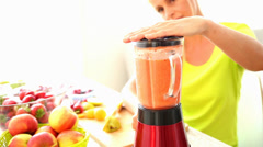 Mature woman preparing a smoothie - stock footage