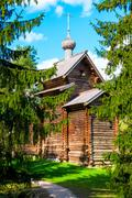 russian traditional old church in the woods - stock photo