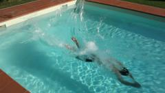 Man diving in swimming pool water Stock Footage