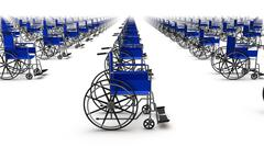 Side view of endless Wheelchairs - stock photo