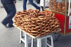 Traditional turkish street food, pretzels with sesame Stock Photos