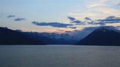 Beautiful last light of day as cruise ship departs Skagway, Alaska-HD P-3220 Stock Footage
