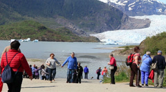 Tourists stroll the beach at Mendenhall Glacier, AK-HD P-3165 Stock Footage