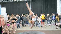 Pole dance, young sportswoman show acrobatic program on pylon, Stock Footage