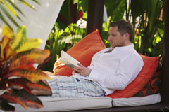 Man finish reading book and enjoying resting in the garden Stock Footage