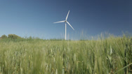 Stock Video Footage of wind turbine in green wheat field