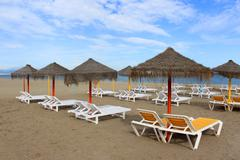 Sun shades and loungers in torremolinos, spain Stock Photos