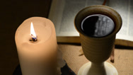 Stock Video Footage of flaming candle and chalice of wine,locked down