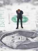 Figure of businessman on one dollar bill Stock Photos