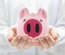 Man holding big pink piggy bank Stock Photos