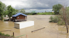 Flooded refrigerator car raft house in turbulent river flow. Stock Footage