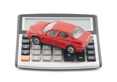 Calculator and red toy car with clipping path Stock Photos