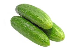 Stock Photo of three green cucumbers taken closeup.isolated.