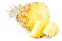 ripes pineapple with slices isolated on white - stock photo
