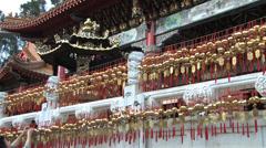 Tying a prayer in Sun Moon Lake Wenwu Temple in Taiwan Stock Footage