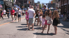 Summer in the city during gay pride street festival with tourists in town. Stock Footage