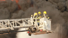 Over 120 firefighters battle blaze in packaging factory Stock Footage