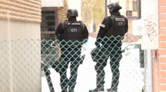 Heavily armed swat officers at standoff Stock Footage